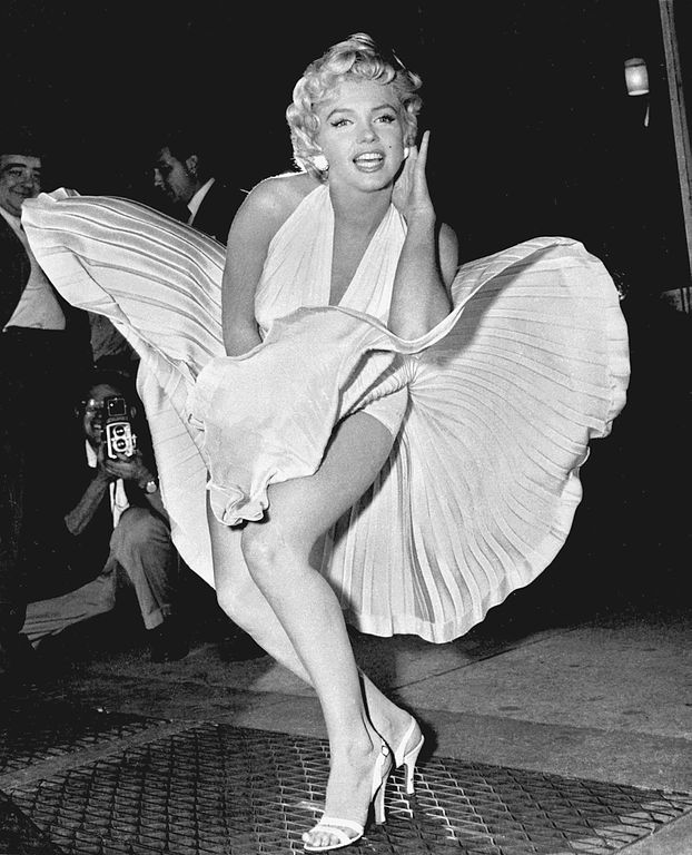 Marilyn Monroe posing for photographers while filming the subway grate scene in Manhattan for The Seven Year Itch